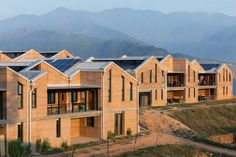 Using rammed earth was a way of making the rural hospital complex, which is designed to treat 100,000 patients a year, both low cost and more sustainable. Hospital Architecture, Architecture Office, Architecture Design, Sharon Davis, Nepal, Rural Health, Rammed Earth, Living Place, Built In Furniture