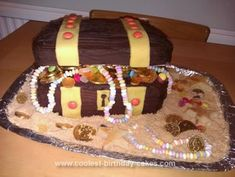 Homemade Pirate Treasure Chest Birthday Cake: I was inspired by other treasure chest cakes on this website to make this Pirate Treasure Chest birthday cake for my son's 4th birthday.   I made 3 square