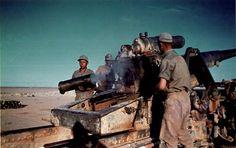 """Gunners of Afrikakorps (DAK- Deutsches AfrikaKorps ) make fire with a heavy howitzer-cannon """"17cm Kanone 18 in Mörserlafette"""" in North Africa in 1941."""