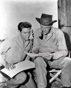 Elvis between take on the movie set Flaming Star in august 1960,here with actor John McIntire.