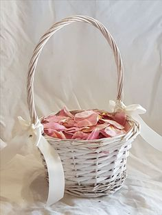Baby pink freeze dried roses with flower girl basket from www.freezedriedrosepetals.com.au visit our page for wedding decoration ideas including aisle scatter..confetti throwing cones...romance hamper plus more