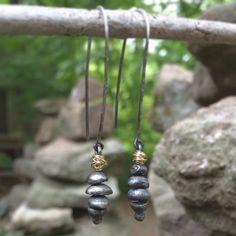 """Balance"" earrings in blackened Sterling and 14k yellow gold #earrings #handcrafted #instasmithy #instajewelry #instajewelrygroup #riojeweler #etsyjeweler #etsy #makerlady #makermovement #scrapandsmith #metalsmith #handmadejewelry #rocks #nature #pebbles #outdoors #adventure"