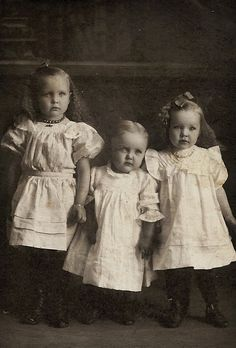 Sisters old pic of three adorable little girls. probably taken around the 1900's. wonder how their lives turned out??