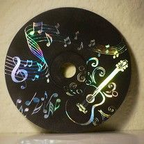make DIY magic scratch art thingies out of old CDs.. Party craft idea
