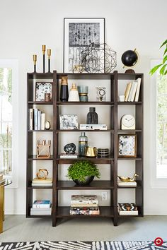 Style Tip from Target Home Style Expert, Emily Henderson: Bookshelves aren't just for books. They're for memories, inspiration and sharing your personal style. When styling a bookshelf, continue the color scheme of the room with what you place on the shelves. Also, don't feel confined to just styling the interior of your bookshelf—the top is prime real estate for a large statement piece, and draws the eye upward to make the ceiling appear higher.