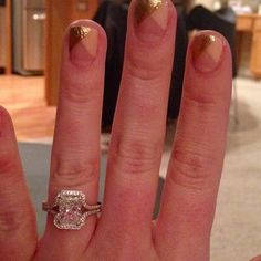 This new bride sure has a gorgeous #ring. #manicure isn't bad either! #shesaidyes #engaged #14karatomaha #diamond