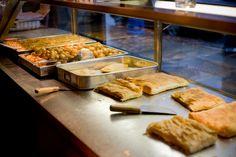 Athens Bakery: Best Loukoumades (deep fried dough balls with honey!), Spanikopita (spinach and cheese pie), and Bougatsa (custard pie). Best Restaurants In Toronto, Pastry Logo, Good Bakery, Chocolate Trifle, Cheese Pies, Dough Balls, Spinach And Cheese, Baked Goods