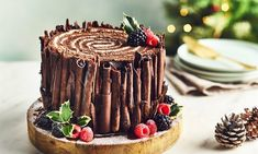 Woodland Christmas Yule Log Cake Recipe: Put a twist on the traditional Yule Log with this Woodland style Christmas cake with edible chocolatey bark. A great centrepiece for a birthday party, too.- One of hundreds of delicious recipes from Dr. Chocolate Yule Log Recipe, Chocolate Log, Chocolate Christmas Cake, Köstliche Desserts, Christmas Desserts, Plated Desserts, French Desserts, Christmas Cakes, Food Cakes