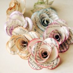 Paper flowers out of book pages - super cute!
