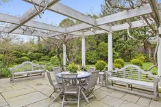 Photo 10 of 12 in Jackie O's East Hampton Childhood Summer Home Just Hit the Market for $7.5M - Dwell Hamptons House, The Hamptons, Shingle Style Homes, Home Porch, Grey Gardens, Covered Pergola, East Hampton, Real Estate Companies, Courtyards
