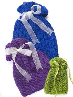 Nifty Knit Gift Bags | AllFreeKnitting.com These adorable DIY gift bags will make all of your gifts look spectacular. These Nifty Knit Gift Bags are the perfect way to wrap your presents.