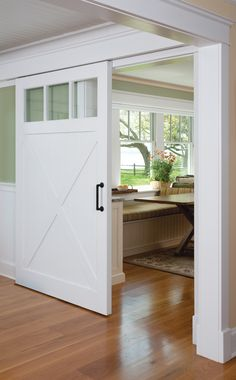 Sliding barn doors to separate living spaces