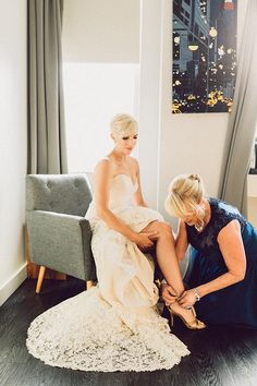 Always love seeing moms help their daughters get ready on the wedding day | @ambergress | Brides.com