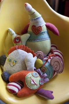 Imaginative little plushies made from old clothing scraps