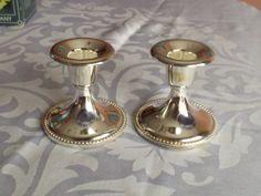 Silverplated candlesticks in pair.International by HuntWithJoy,