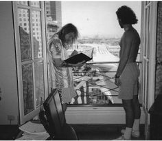 """Axl looking over the room service menu somewhere in Argentina. Out that window are hundreds, maybe thousands of fans. Robert looks on. Duswalt, Craig (2014-05-13). Welcome to My Jungle: An..."