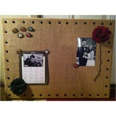 """Burlap covered cork board, push pins made out of scrapbooking """"charms"""" and felt flowers. Lined edges with decorative nails. Total cost to make this: $11"""