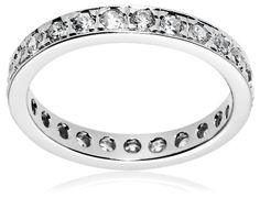 Create the look of luxury at an affordable price with the Sterling Silver Cubic Zirconia Eternity Ring. The bezel-style setting showcases the miraculous cut and brilliant shine of the cubic zirconia stones that fill the entire eternity band. A gentle touch of sparkle that is emphasized against the sterling silver, this simple band is great for layering with other silver rings and diamond jewelry.