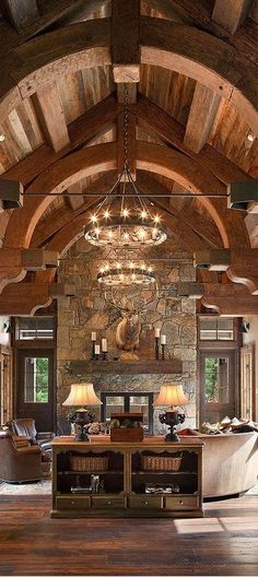 Elegant and rustic decor. Love the curved beams and double chandeliers.