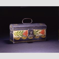 """TRUNK/ Artist unidentified, Eastern United States, c. 1830–1840, paint on asphaltum over tinplate, 3 1/4 × 7 × 3 5/8"""", collection American Folk Art Museum, gift of the Historical Society of Early American Decoration, courtesy Mrs. Clinton B. Burnett: 73.1.6. Photo credit: John Parnell."""