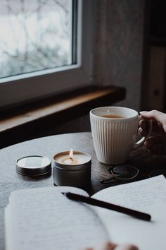 Cosy candles and mugs of tea. Photography and lifestyle inspiration.  #lifestylephotography #lifestyleblogger #slowliving