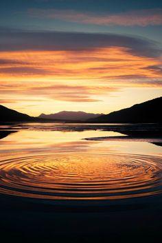 Beautiful ripples on a sunset lake