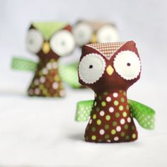 Owl rattle (on etsy). Looks like quilting cotton (or flannel), felt, ribbon, and a rattle!