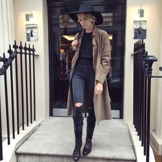 trench coat + black floppy hat, ripped skinny jeans and boots