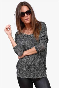 The most comfortable Knit Sweater around!  Has an overall baggy fit and would look killer with high waist jeans and pumps.