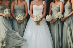 I like how the bridesmaid's dresses match the criss-cross style of the wedding dress