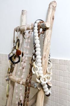 Use a ladder or old chair to hang jewelry and scarfs