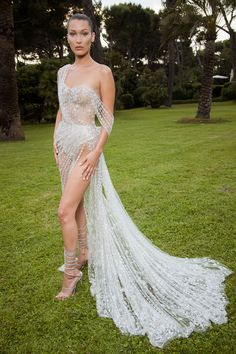 She wore a barely-there gown by British couturiers Ralph and Russo for the amFAR Gala in Cap d'Antibes.