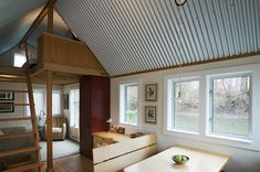 Isn't that galvanized wavy sheet metal lovely for ceiling material? via small house swoon