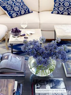 A Naples, Florida, living room sets the stage for the rest of the house — bold pattern, blue and white, straightforward furniture.