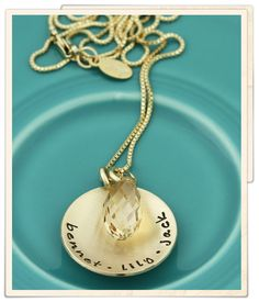 <p> golden names and a crystal</p>