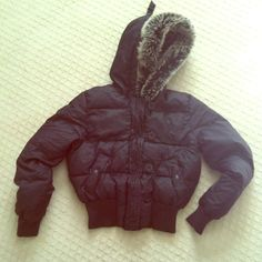 JLO black puffy jacket w/ fur lined hood One off he warmest jackets I've ever owned. It is puffy and filled with down material. In excellent condition. It just doesn't get cold enough I'm LA for me to give it enough love JLO  Jackets & Coats