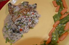 Round 2: Cook of the Week Challenge contestant Chris Crabtree serves her stuffed pork chop with glazed carrots and snow peas.