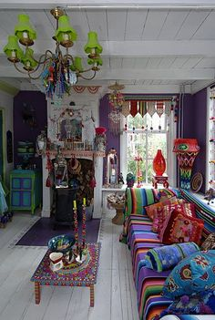 Colorful bohemian decor with clean, white-painted wood floors, walls, and ceiling as a backdrop - awesome! I love it!!!