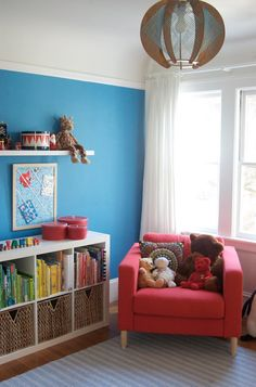 #Ikea storage, blue #paint color, white #window panels, and an adorable string pendant #light create a cozy #nursery