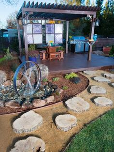 In this home in the Sierra foothills, a formerly boring backyard gets a redress with a redwood deck and pergola, outdoor kitchen and this custom water feature.