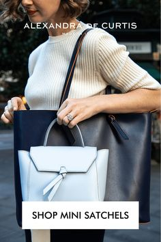 The Siena Mini Satchel is the ideal size when all you need is your phone, a wallet, keys and some beauty essentials. Great for a night out, or a weekend shopping excursion. Carry it by hand or over the shoulder thanks to its practical shoulder strap. The Siena is designed for longevity thanks to our smooth and easy to clean leather that holds its shape over time amazingly well. Subscribe to our mailing list to get 10% off your first order: www.alexandradecurtis.com/join Italian Leather Handbags, Designer Leather Handbags, Blue Handbags, Satchel Handbags, Italian Street, How To Make Handbags, Beauty Essentials, Italian Fashion, Classic Leather