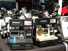 Ah good ol' polaroid. A historical tour of cameras on one table.