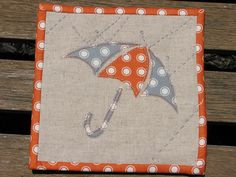 Mug Rug for the Zakka Style Sew Along.  I wanted to keep to the same fabrics that I have used for many of my ZSSA projects.  I also wanted to stick with the spirit of the original example, so I thought the umbrella was a good solution!