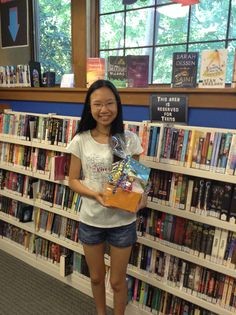 """Congrats to raffle winner Dana who won the teen summer reading raffle basket """"Night Out on the Town"""" (movie and pizza gift certificates and lots of candy!). Way to go!"""