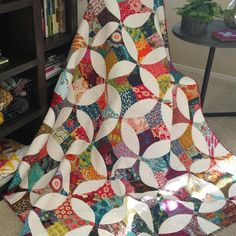 "For my post today of ""Finally Finished"", for the #igquiltfest , I submit my AMH Flowering Snowball Quilt!  This quilt took me forever, and I think I finally finished it in May 2016!  I was new to curves (still am) and I often started it and then stopped.  I decided to take it with me to my first sewing retreat, which was SEWTOPIA Portland, and ask for help by the lovely @trilliumdesign !  She was able to very quickly steer me in the right direction!  Once I was curve chain piecing like a…"