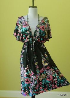 This butterfly dress would be cute with some cute sandals for the summer wear :)