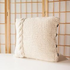 """Cable Me Cozy Pillow Cover/ Yardage: 220 Needles/Hooks Suggested: Size 13 (9mm): 32"""" or longer circular needles Fiber Type: Alpaca & Blends Weight: Super Bulky"""
