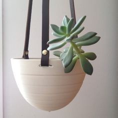 Hey, I found this really awesome Etsy listing at https://www.etsy.com/listing/228183002/hanging-planter-in-ceramic-and-recycled