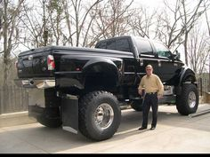 Ford F650 ~ The teeny tiny mini thing is the man standing next to the car! kn