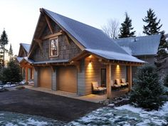 The garage exterior showcases an impressive gable end complete with eco-friendly poplar bark siding and hemlock timbers, cut and milled locally.